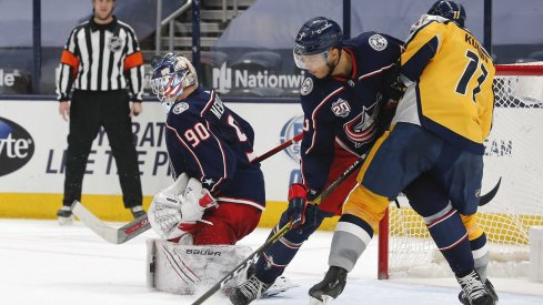 Feb 18, 2021; Columbus, Ohio, USA; Columbus Blue Jackets goalie Elvis Merzlikins (90) makes a save against the Nashville Predators during the second period at Nationwide Arena.