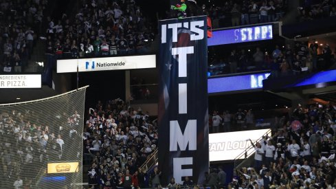 Apr 16, 2019; Columbus, OH, USA; Columbus mascot Stinger stands over the It's Time banner prior to game four of the first round of the 2019 Stanley Cup Playoffs in the game of the Tampa Bay Lightning against the Columbus Blue Jackets at Nationwide Arena.