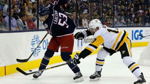 Sep 28, 2018; Columbus, OH, USA; Columbus Blue Jackets defenseman Gabriel Carlsson (53) passes the puck away from Pittsburgh Penguins right wing Bryan Rust (17) during the first period at Nationwide Arena.