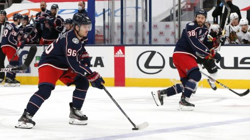 Columbus Blue Jackets center Jack Roslovic (96) controls the puck as he enters the Chicago Blackhawks zone during the first period at Nationwide Arena.
