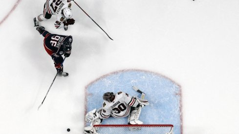 Chicago Blackhawks goalie Malcolm Subban (30) makes a save from the shot of Columbus Blue Jackets center Jack Roslovic (96) during the first period at Nationwide Arena.