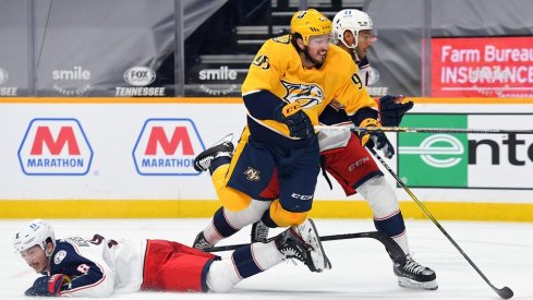 Nashville Predators center Matt Duchene (95) is hit by Columbus Blue Jackets defenseman Zach Werenski (8) and defenseman Seth Jones (3) as he skates toward the net during the third period at Bridgestone Arena.