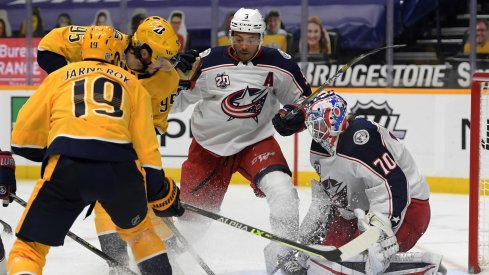 Columbus Blue Jackets goaltender Joonas Korpisalo (70) blocks a shot by Nashville Predators center Matt Duchene (95) during the third period at Bridgestone Arena.