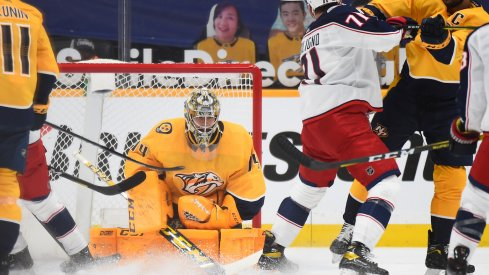 Nashville Predators goaltender Juuse Saros (74) makes a save during the first period against the Columbus Blue Jackets at Bridgestone Arena.
