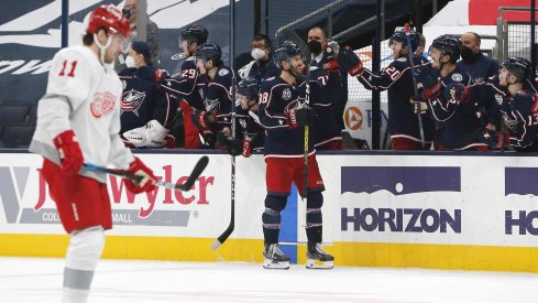 Mar 2, 2021; Columbus, Ohio, USA; Columbus Blue Jackets center Boone Jenner (38) celebrates a goal with teammates against the Detroit Red Wings during the second period at Nationwide Arena.