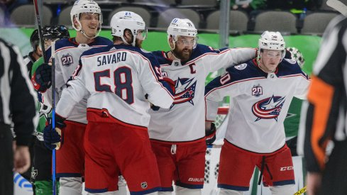 The Columbus Blue Jackets celebrate a goal scored against the Dallas Stars at American Airlines Center.