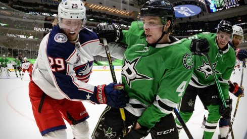 Columbus Blue Jackets right wing Patrik Laine (29) and Dallas Stars defenseman Miro Heiskanen (4) fight for the puck during the third period at the American Airlines Center.
