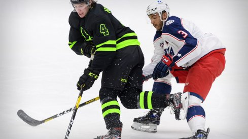 Mar 6, 2021; Dallas, Texas, USA; Dallas Stars defenseman Miro Heiskanen (4) is tripped by Columbus Blue Jackets defenseman Seth Jones (3) during the first period at the American Airlines Center.