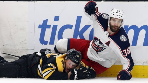 Columbus Blue Jackets forward Boone Jenner competes for the puck against Brady Skjei of the Carolina Hurricanes at Nationwide Arena.