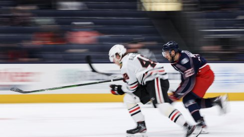 Chicago Blackhawks defenseman Wyatt Kalynuk (48) skates against Columbus Blue Jackets left wing Stefan Matteau (23) for the loose puck in the first period at Nationwide Arena.