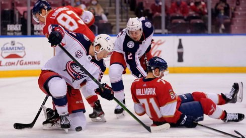 Apr 19, 2021; Sunrise, Florida, USA; Columbus Blue Jackets center Josh Dunne (21) blocks the puck against the Florida Panthers during the second period at BB&T Center.