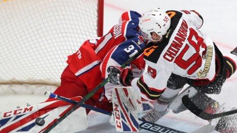 Yegor Chinakhov runs into goaltender Lars Johansson