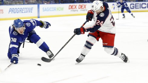 Columbus Blue Jackets left wing Nathan Gerbe (24) passes the puck as Tampa Bay Lightning defenseman Mikhail Sergachev (98) during the second period at Amalie Arena.