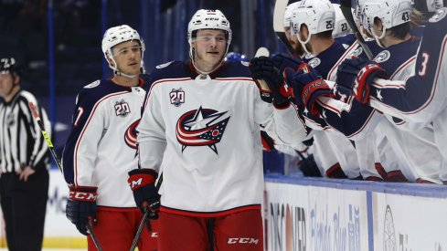 Apr 25, 2021; Tampa, Florida, USA; Columbus Blue Jackets left wing Eric Robinson (50) is congratulated as he scores a goal against the Tampa Bay Lightning during the third period at Amalie Arena.