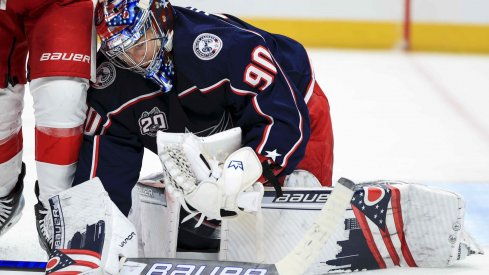 Apr 27, 2021; Columbus, Ohio, USA; Columbus Blue Jackets goaltender Elvis Merzlikins (90) makes a save in net against the Detroit Red Wings in the second period at Nationwide Arena.