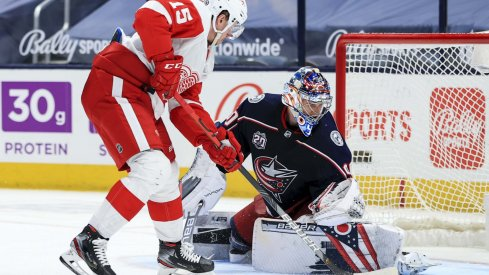 Apr 27, 2021; Columbus, Ohio, USA; Columbus Blue Jackets goaltender Elvis Merzlikins (90) makes a save in net against Detroit Red Wings left winger Jakub Vrana (15) in the overtime period at Nationwide Arena.