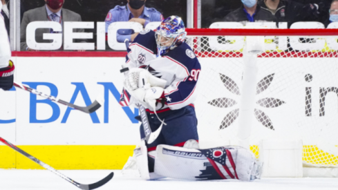 Elvis Merzlikins makes a save during second period action in the Columbus Blue Jackets overtime loss to Carolina.