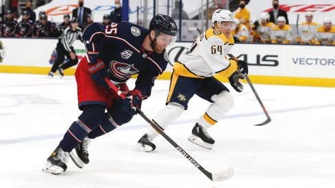 May 5, 2021; Columbus, Ohio, USA; Columbus Blue Jackets center Mikhail Grigorenko (25) controls the puck as enters the zone against the Nashville Predators during the first period at Nationwide Arena.