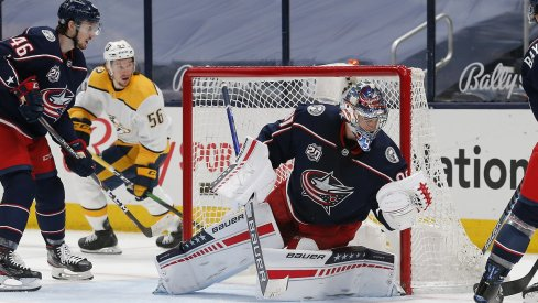 Elvis Merzlikins makes a save against the Nashville Predators