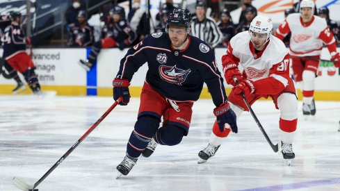 Apr 27, 2021; Columbus, Ohio, USA; Columbus Blue Jackets center Max Domi (16) controls the puck against Detroit Red Wings center Joe Veleno (90) in the third period at Nationwide Arena.