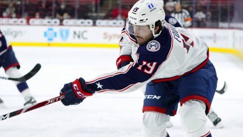 Columbus Blue Jackets center Liam Foudy (19) takes a first period shot against the Carolina Hurricanes at PNC Arena.
