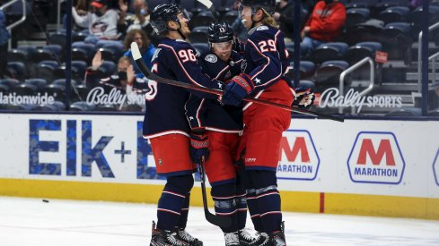 May 8, 2021; Columbus, Ohio, USA; Columbus Blue Jackets right wing Cam Atkinson (middle) celebrates with teammates center Jack Roslovic (left) and right wing Patrik Laine (right) after scoring a goal against the Detroit Red Wings in the 1st period at Nationwide Arena.