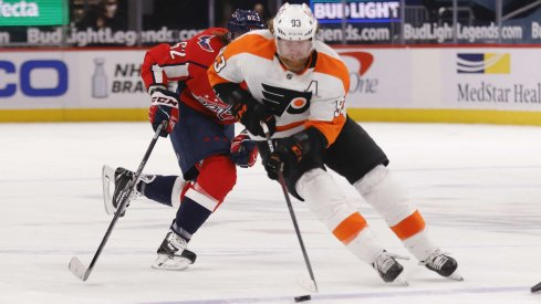 May 8, 2021; Washington, District of Columbia, USA; Philadelphia Flyers right wing Jakub Voracek (93) skates with the puck as Washington Capitals left wing Carl Hagelin (62) chases in the third period at Capital One Arena.