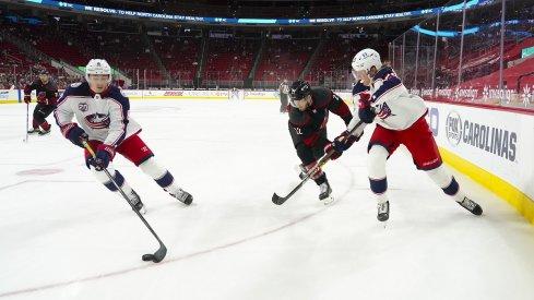 Zach Werenski and Patrik Laine skate against the Carolina Hurricanes