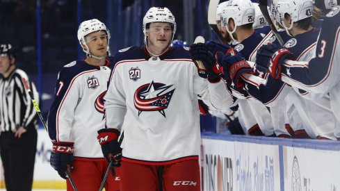 Apr 25, 2021; Tampa, Florida, USA; Columbus Blue Jackets left wing Eric Robinson (50) is congratulated as he scores a goal against the Tampa Bay Lightning uring the third period at Amalie Arena.