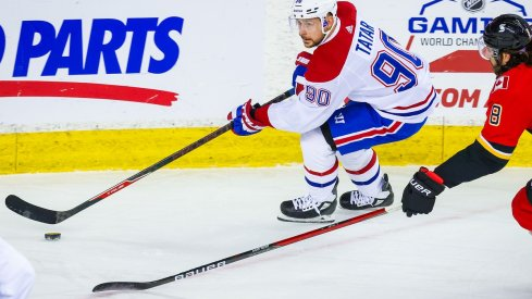 Tomas Tatar protects the puck against the Calgary Flames