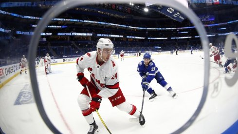Carolina Hurricanes defenseman Jake Bean (24) skates with the puck as Tampa Bay Lightning center Blake Coleman (20) attempts to defend during the second period at Amalie Arena.