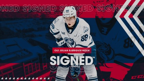 Ole Julian Bjorgvik-Holm signs his entry-level contract.
