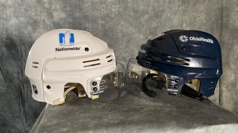 Blue Jackets helmets with advertisements.