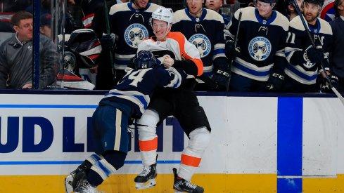 Nathan Gerbe fights Travis Sanheim at Nationwide Arena.