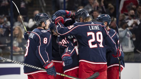 Oct 21, 2021; Columbus, Ohio, USA; Columbus Blue Jackets center Boone Jenner (38) celebrates with his team after scoring a goal against the New York Islanders in the second period at Nationwide Arena.