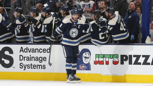 Oct 23, 2021; Columbus, Ohio, USA; Columbus Blue Jackets center Boone Jenner (38) celebrates a goal against the Carolina Hurricanes during the second period at Nationwide Arena.