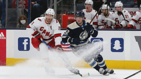 Oct 23, 2021; Columbus, Ohio, USA; Carolina Hurricanes center Jordan Staal (11) and Columbus Blue Jackets center Alexandre Texier (42) battle for the puck during the first period at Nationwide Arena.