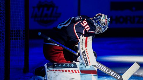 Oct 21, 2021; Columbus, Ohio, USA; Columbus Blue Jackets goaltender Elvis Merzlikins (90) stretches before playing against the New York Islanders at Nationwide Arena.