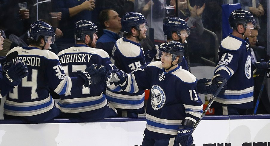 Cam Atkinson celebrates with his Blue Jackets teammates after scoring to put Columbus up 2-0 on Buffalo