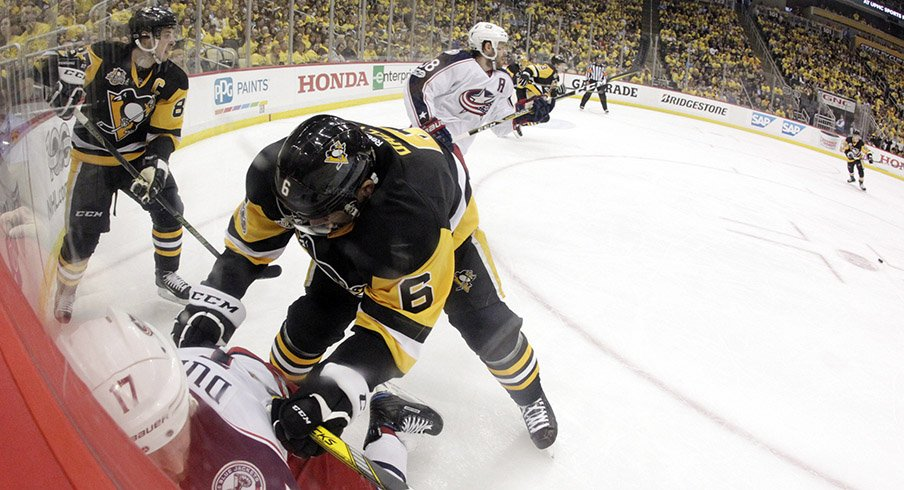 Pittsburgh Penguins defenseman Trevor Daley checks Columbus Blue Jackets center Brandon Dubinsky in the corner during the first period in game one of the first round of the 2017 Stanley Cup Playoffs.