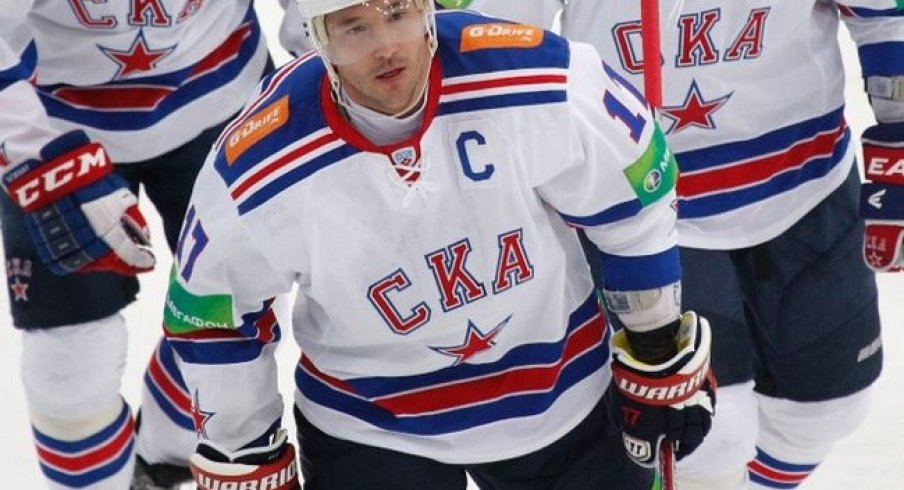 Ilya Kovalchuk celebrates with his teammates after scoring a goal