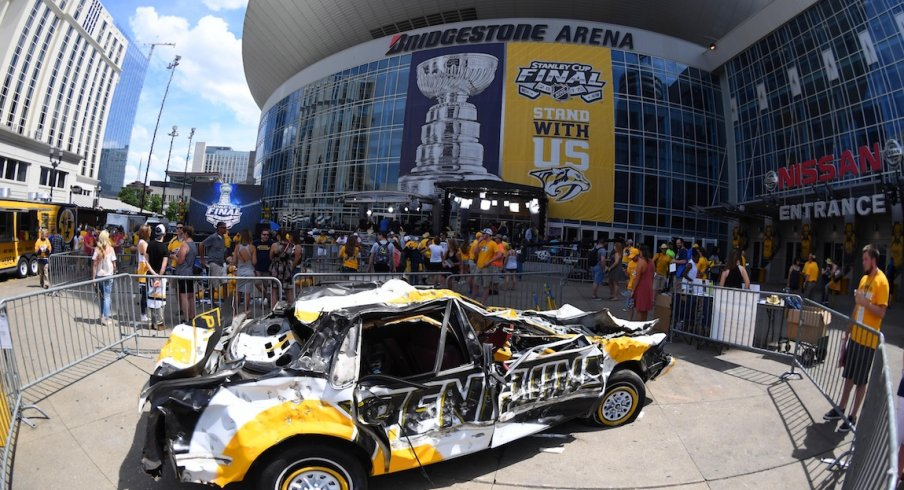 Outside of Bridgestone Arena, Predators' fans beat up on a Penguins car