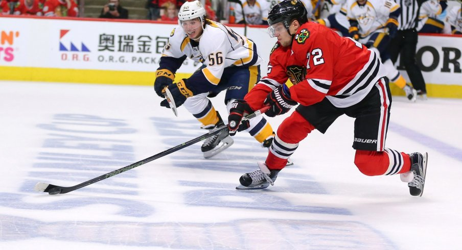 Artemi Panarin skates up the ice with the puck against the Nashville Predators