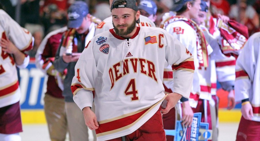 Will Butcher celebrates after the University of Denver won the NCAA National Championship