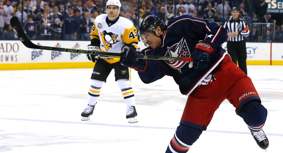 Cam Atkinson shoots a puck versus the Pittsburgh Penguins at Nationwide Arena