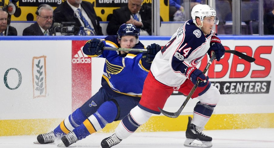 Jordan Schroeder gets tracked down by a St. Louis Blues player during the preseason