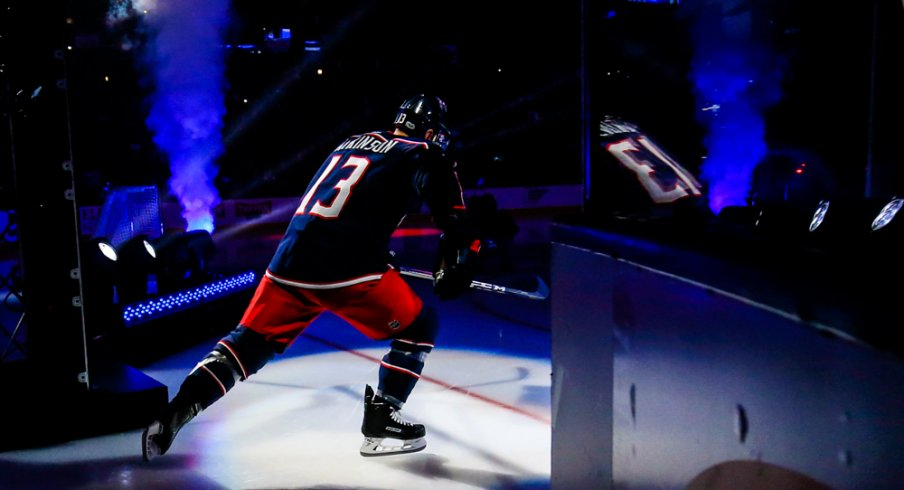 Cam Atkinson skates onto the ice during the Blue Jackets season opener