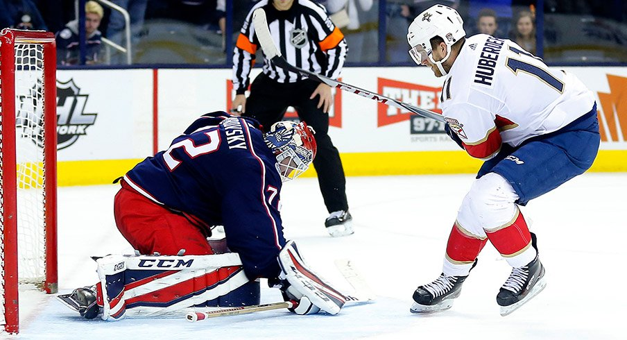 Sergei Bobrovsky makes a save on Jonathan Huberdeau during the Jackets shootout win over the Florida Panthers.