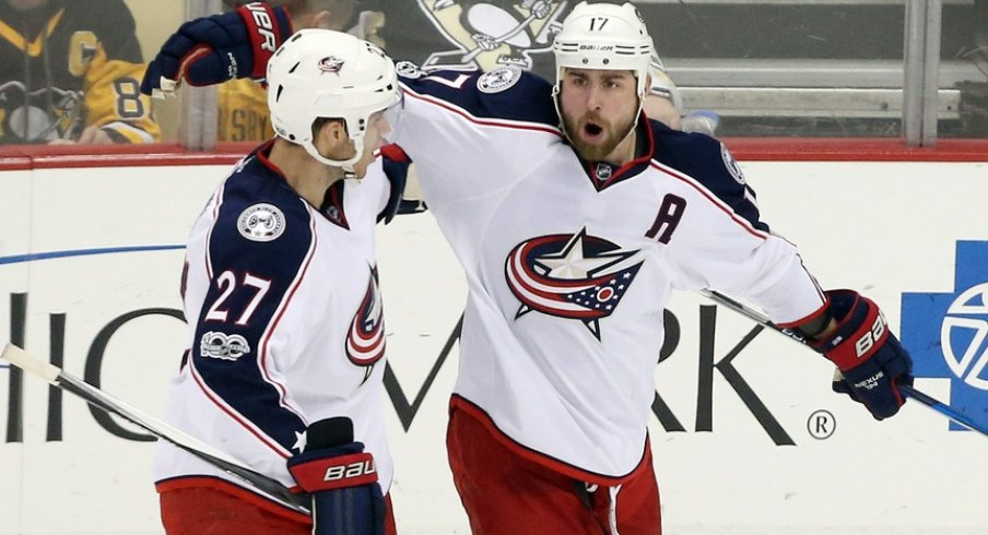 Brandon Dubinsky and Ryan Murray celebrate a goal scored against the Pittsburgh Penguins
