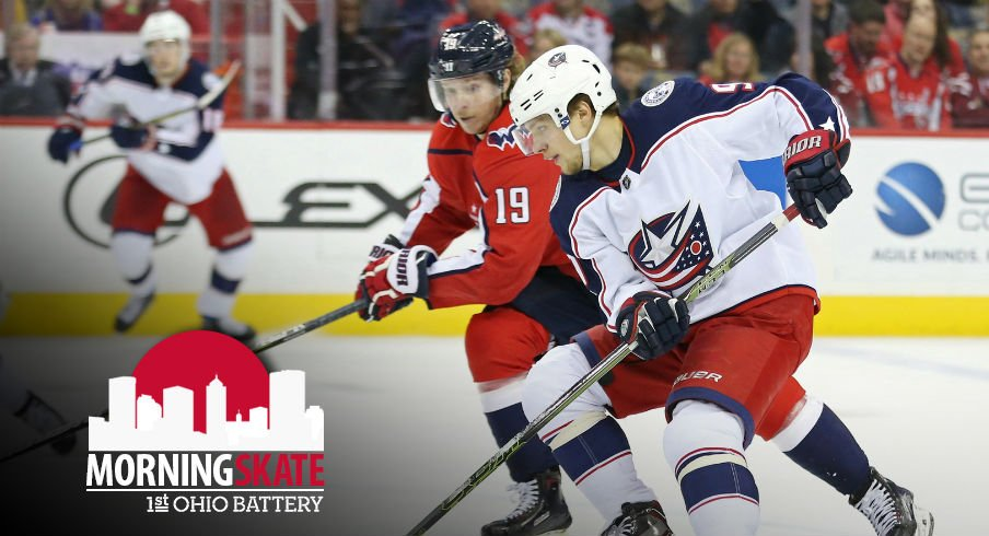 Artemi Panarin carries the puck against the Capitals while Niklas Backstrom  pursues 3b4124754